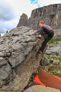 Danielle Jamieson top out an unnamed boulder, Rockbound Lake, Banff
